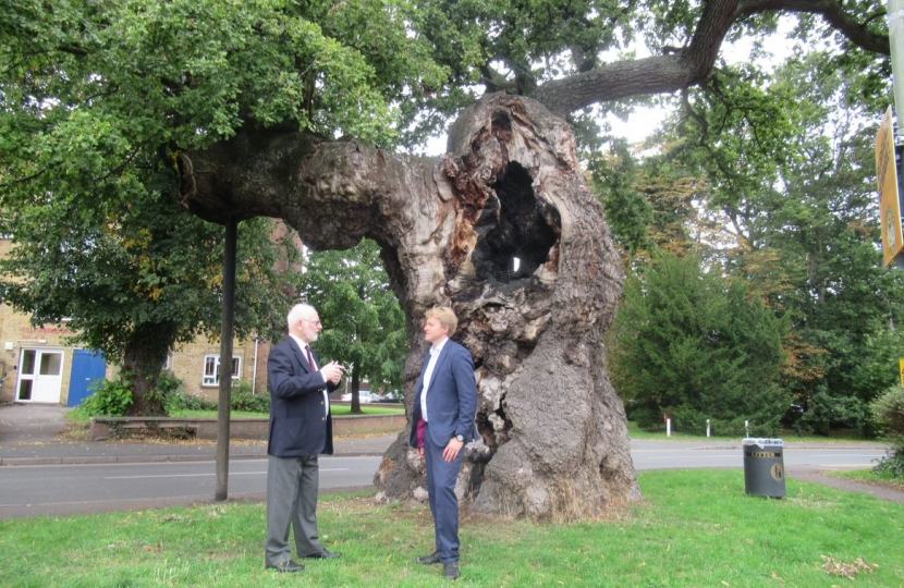 Dr Ben Spencer MP and Mr Ian Mawson, Chairman, Addlestone Historical Society, by the Crouch Oak, Addlestone